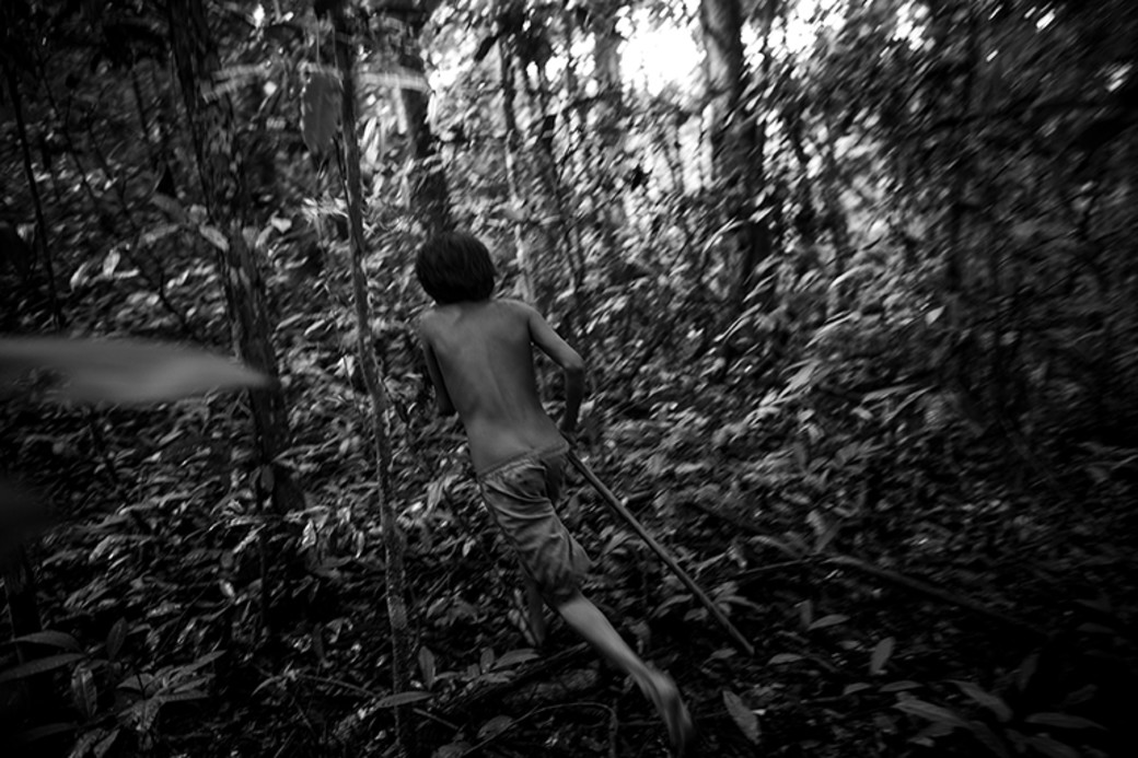 Awa hunters Brazil boy running with spear
