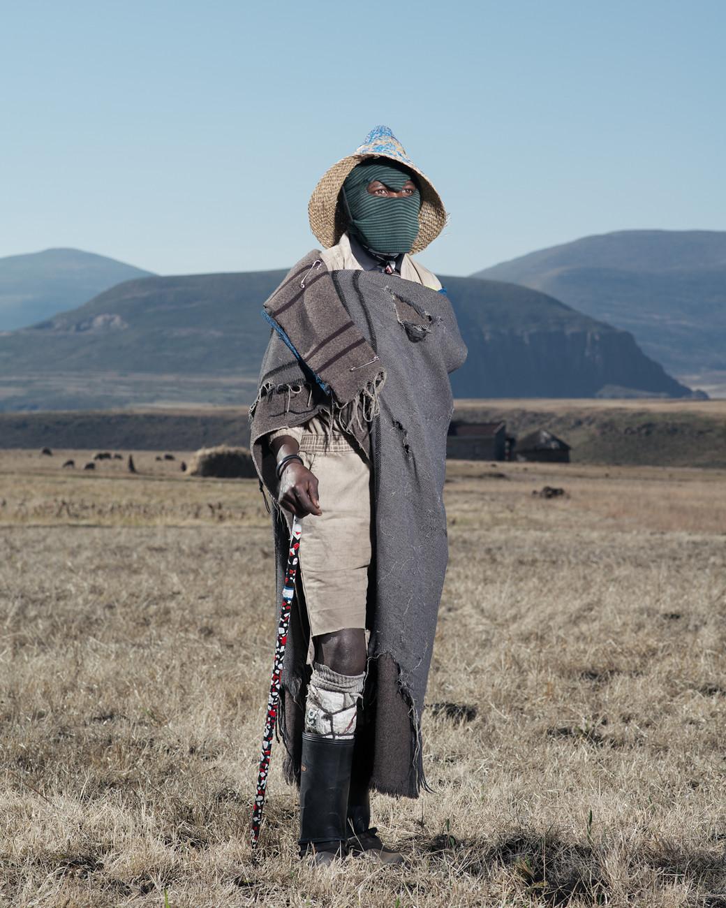 Lesotho herdsmen green balaclava standing