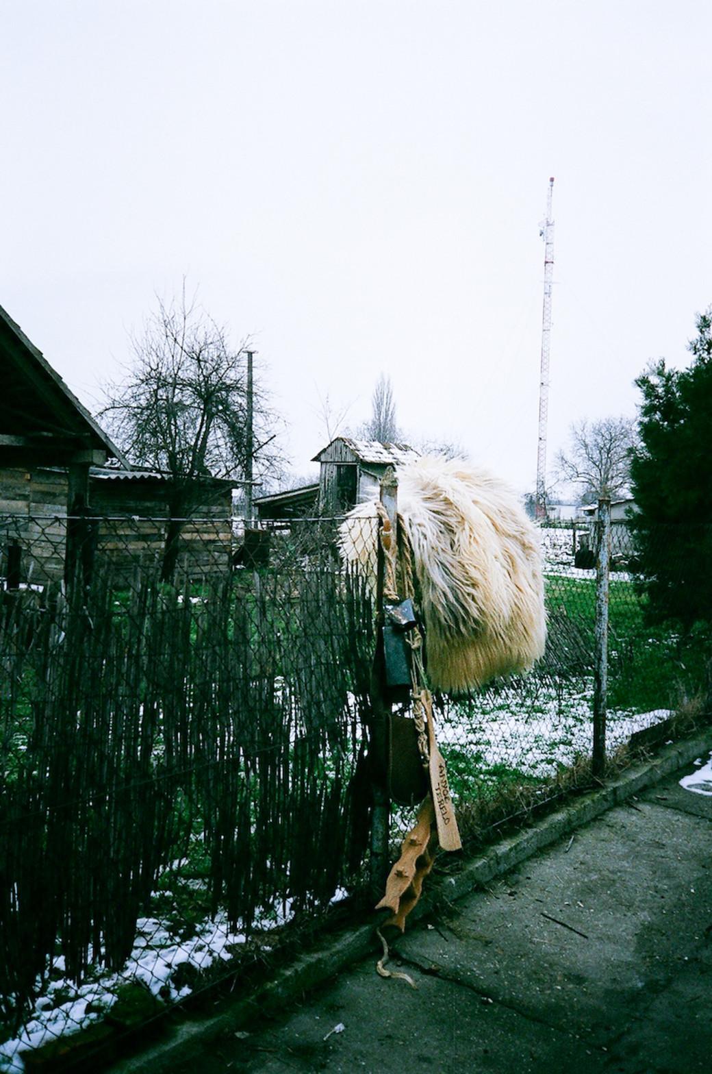 busojaras festival costume hanging on fence