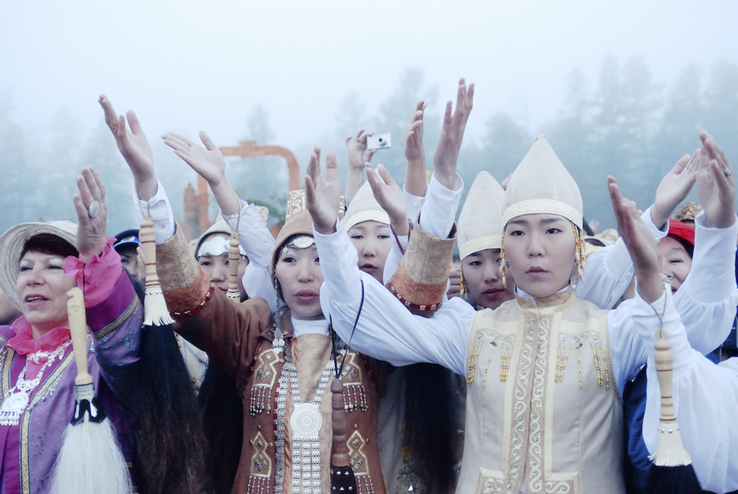 Yakut solstice celebrations Siberia group hands raised